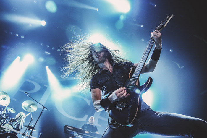 Mark Jansen, the lead guitarist for the metal band Epica in a blue-lit concert.