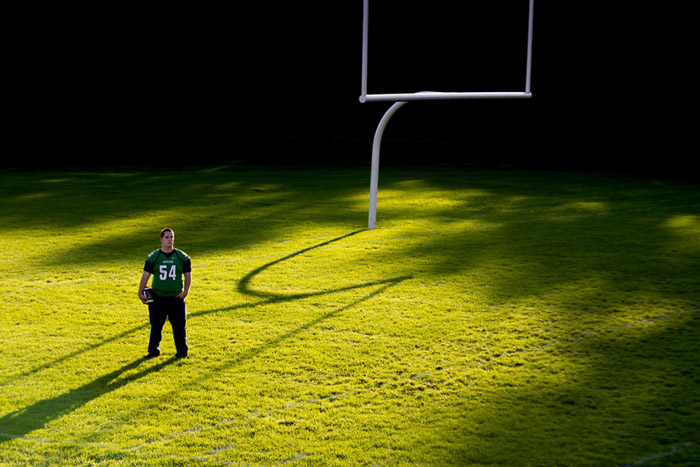 A football player on the field in Golden Hour lighting