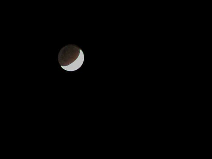 Moon photography shot showing the silhouette of the dark sections illuminated by Earthshine