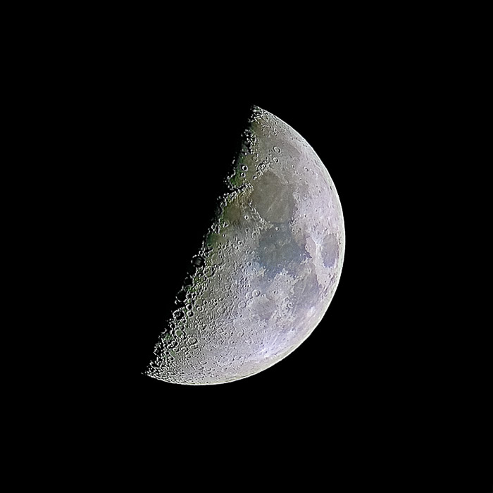 A half moon photo showing high detail of the surface and high contrast near the terminator