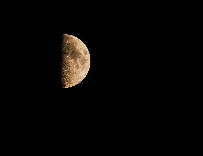 A close up photo of a half moon