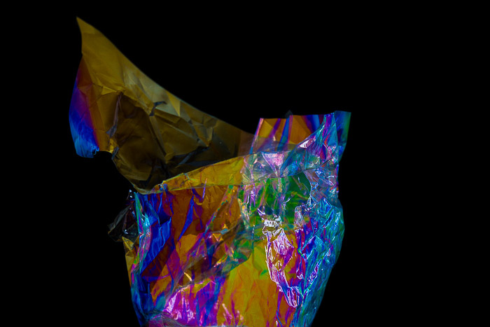 Food wrapper displaying abstract colour effects from photoelasticity