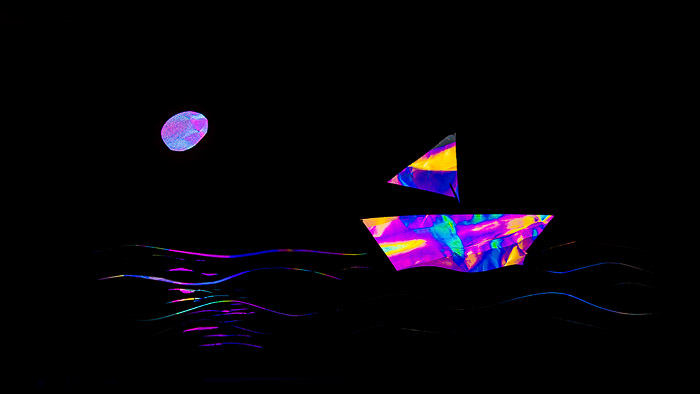 Rainbow effect photoelastic photography of a ship on a moonlit sea