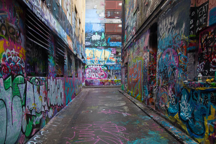 Street view and building walls with heavy colourful graffiti