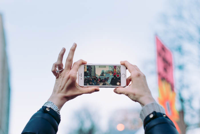 Photographing a protest using a smartphone
