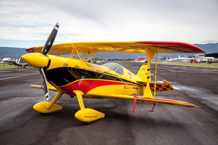 Vibrant seaplane on display at a regional airshow.