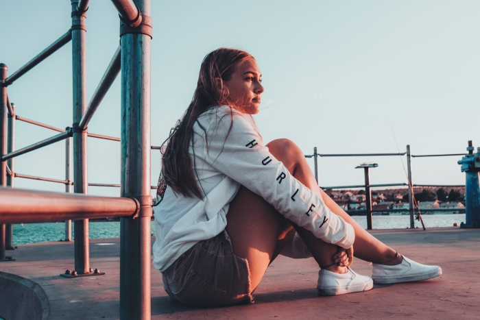 Girl sitting on the floor during golden hour