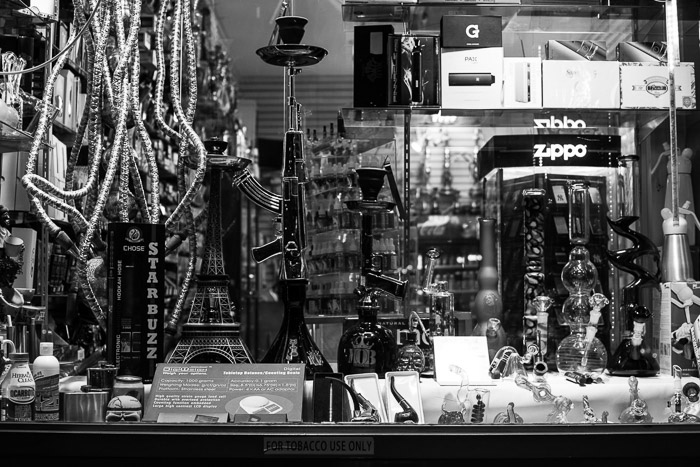 Monochrome shop window controlling reflections. Black and white street photography.