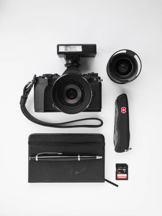 Flat lay of accessories to take with you on your street photography journey