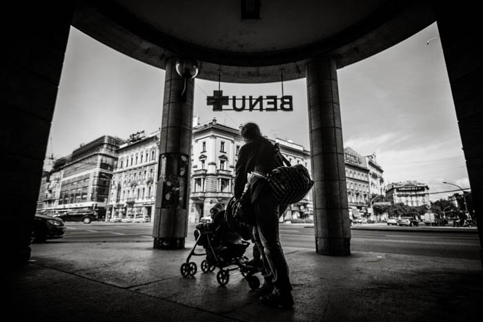 A woman and pushchair walking in the middle of a natural frame
