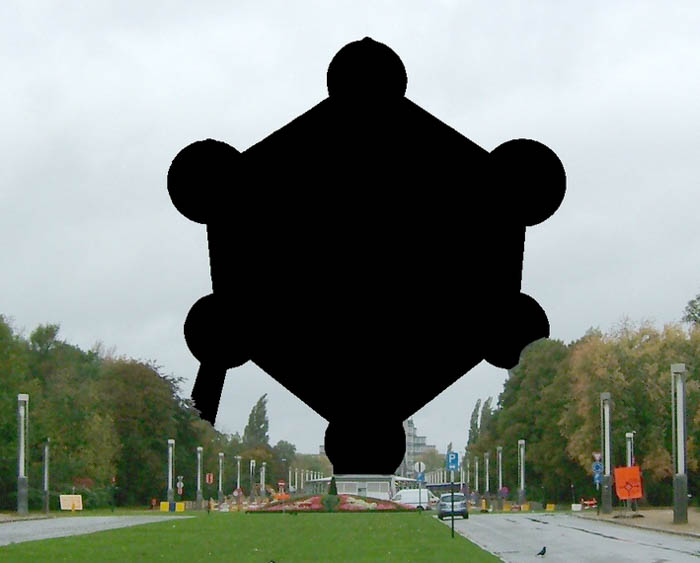 A photograph of a street in Belgium showing a blacked out image of the Atomium