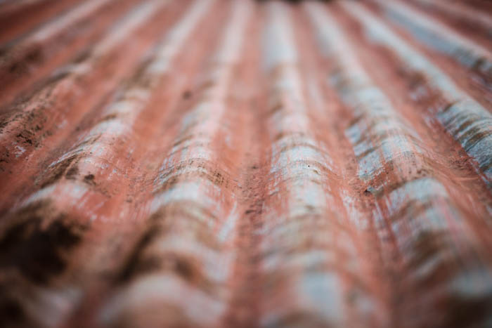 Abstract close up photograph of a sheet of corrugated metal