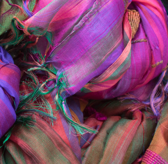 A close up of colored fabrics