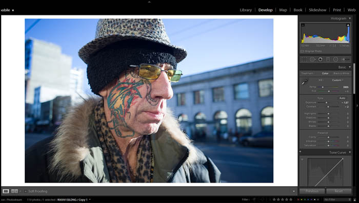 editing street photography exposure and contrast on a picture of an old man with a colourful face tattoo