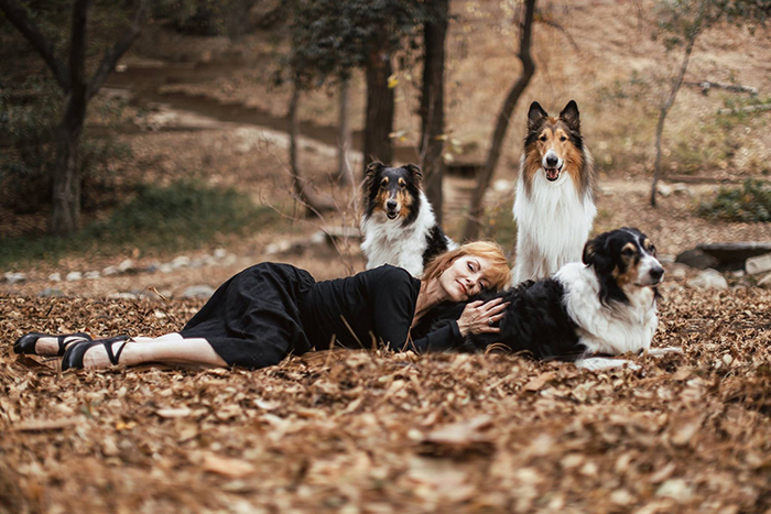 photo of a woman and her dogs