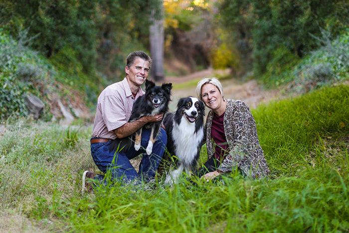 family portrait of a couple and their dogs