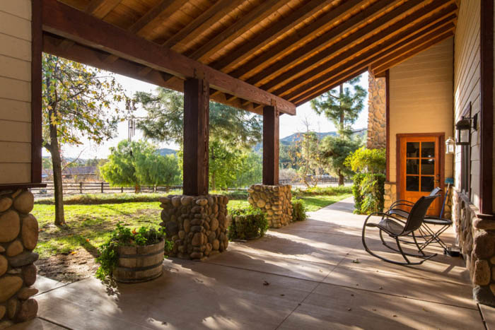 View from inside the patio of a house with a rocking chair to the right