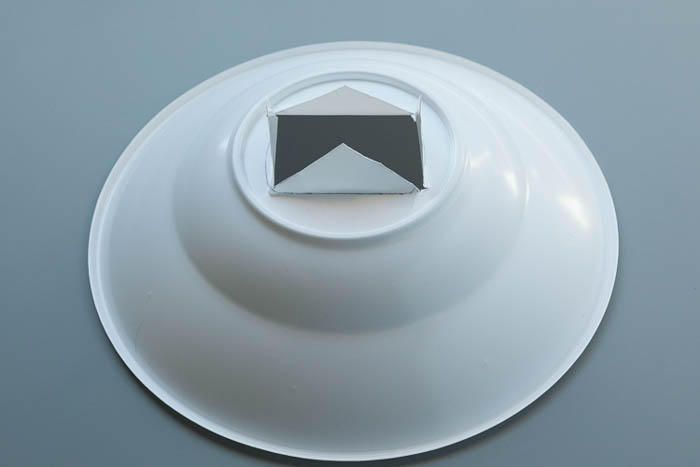 cutting a plastic bowl for diy photography