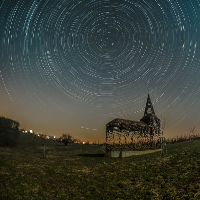 Star trails over the See-through Church in Borgloon, Belgium