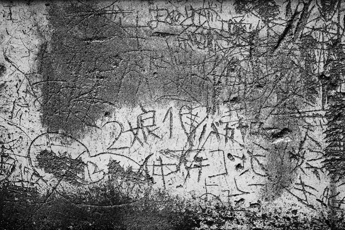 black and white picture of a marked up wall