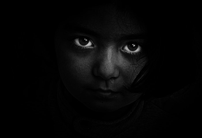 Striking black and white photos of a girl, focused on the eyes
