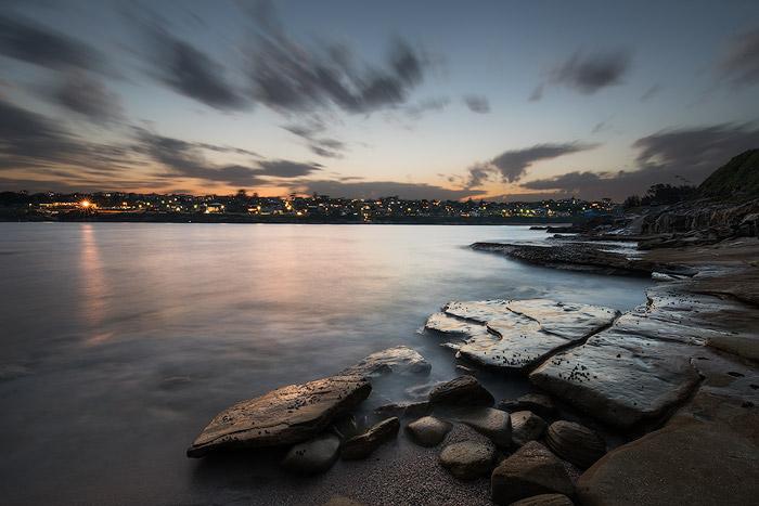 long exposure sunset over a coastal town