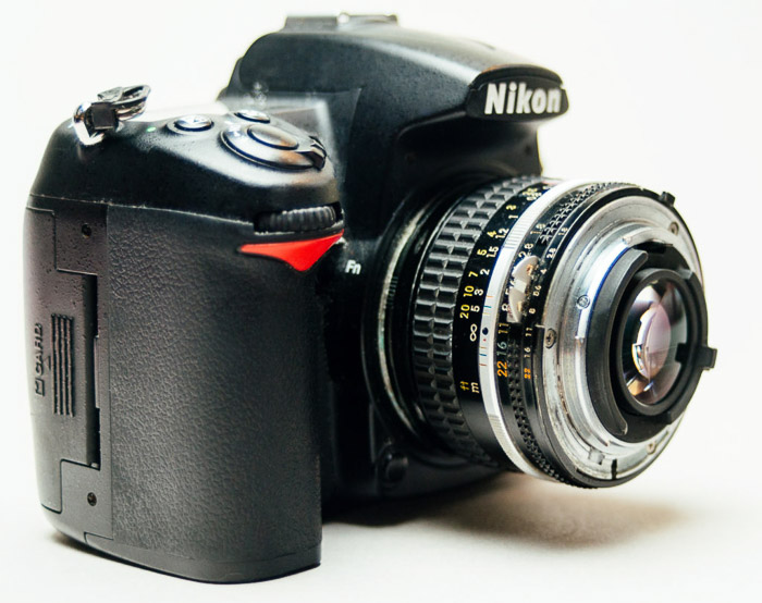 A Nikon DSLR camera with a reversed lens for macro Photography