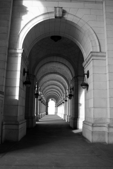 Black and white photo of stone arches
