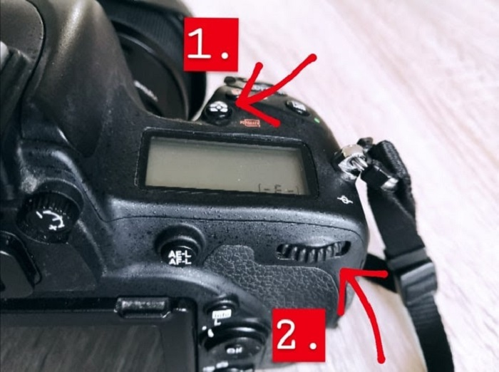 A close up of changing a cameras metering mode