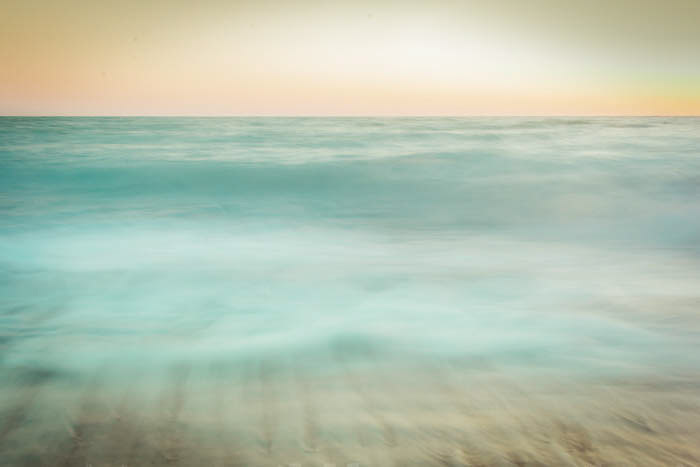After sunset photo of teal coloured waves
