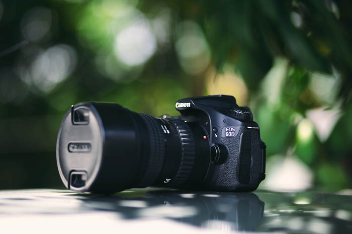 A Canon DSLR camera resting on a table outdoors