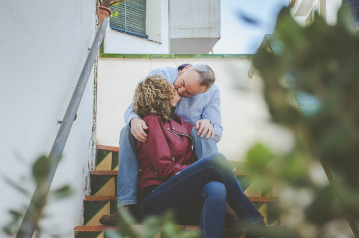a portrait of a couple kissing outdoors - couple photoshoot tips