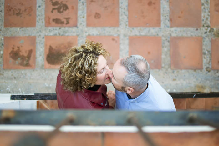 an overhead portrait of a couple kissing