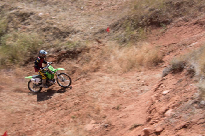using motion blur to artistically photograph a dirt bike rider