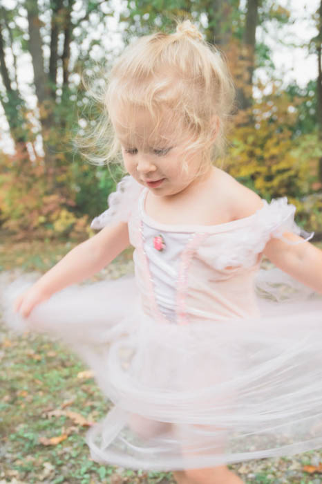 artistic motion blur to photograph a little girl in a tutu spinning