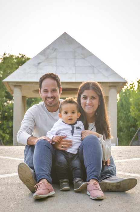 A family poses for the camera in outdoor location