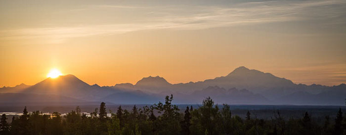 A beautiful panoramic sunset photo of Alaskan landscape