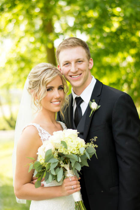 wedding photography of a bride and groom, with photography reflectors used for better light