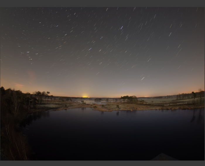 star trails above a lake
