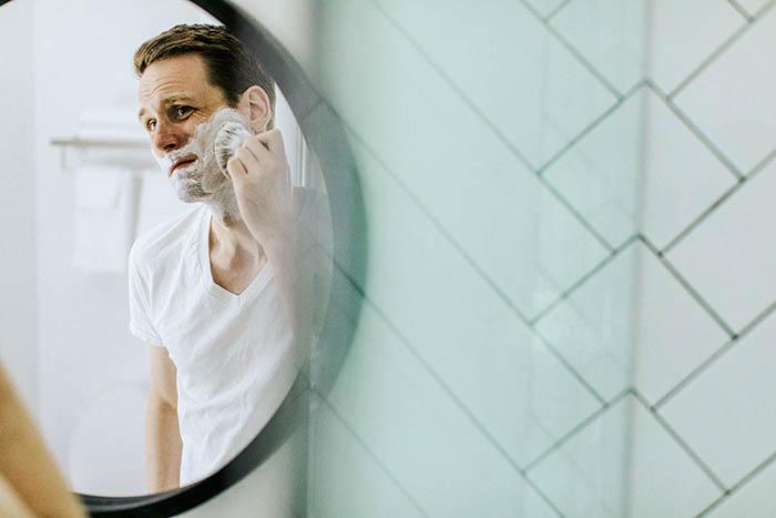 creative self portrait of a man shaving