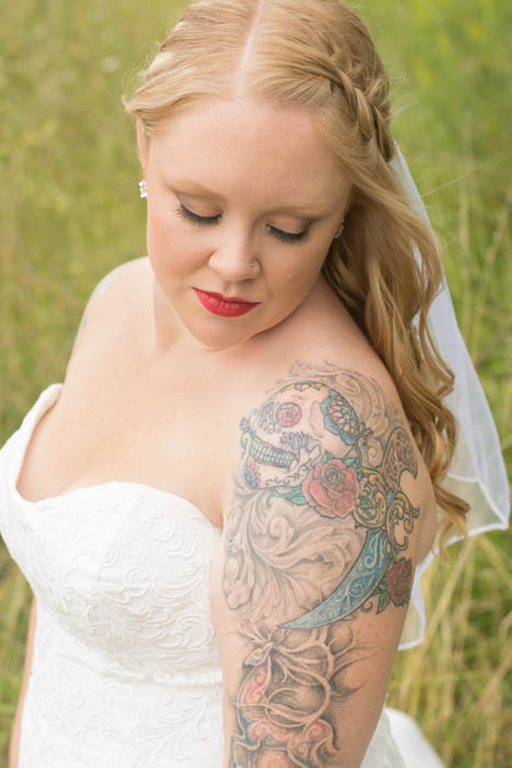 A portrait of a tattooed bride posing outdoors - wedding photography checklist