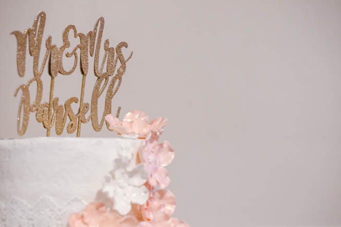 A close up of a Wedding Cake against a light background