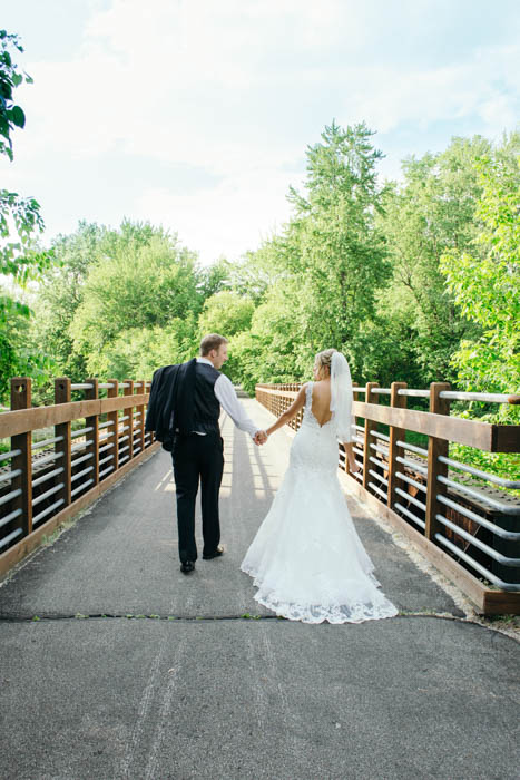 The wedding couple holding hands is a great wedding photography image