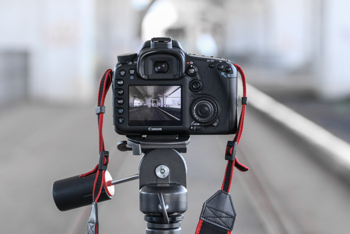 A tripod allows you to capture long exposures for your architecture photography and keeps your hands warm during cold days