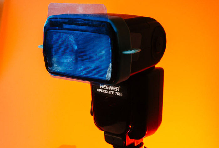 A flash with color gel lighting attached