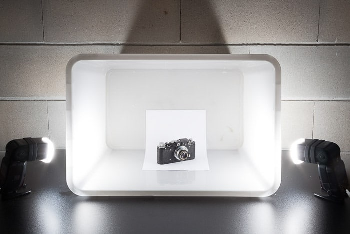 A diy photoshoot setup containing a camera in a White Box Flash Diffuser
