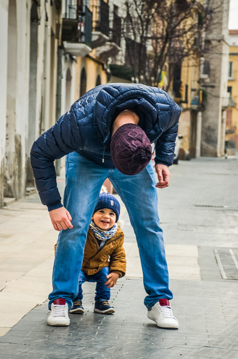 A father and son playing outdoors - family portrait poses