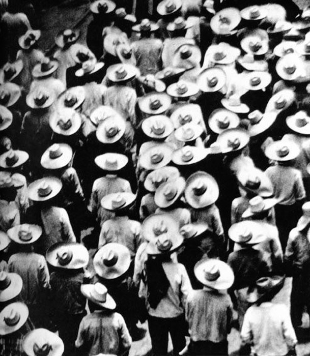 Overhead photo of a crowded street by Tina Modotti