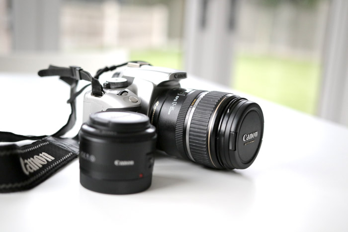 A Canon DSLR camera and lens