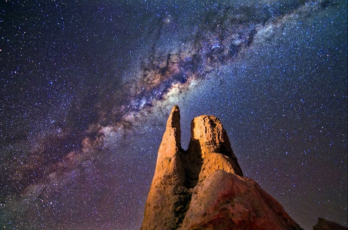 A rock formation with the Milky Way above